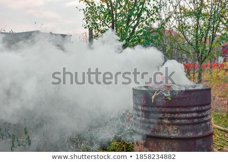 Old rusty barrels with toxic smoke  Stock photo © Elisanth