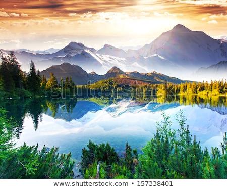 Stock fotó: Halászat · hegy · tó · naplemente · hegyek · tengerpart