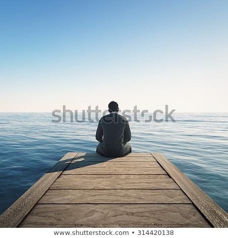 男 座って ドック 見 ボート 湖 ストックフォト © orla