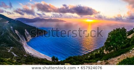 Lélegzetelállító naplemente gyönyörű tengerpart szigetek tájkép Stock fotó © Freesurf
