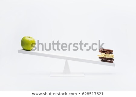 Close-up view of apple and chocolate balancing on seesaw, healthy living concept  Stock photo © LightFieldStudios