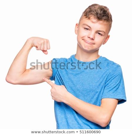 Boy looking at his biceps Stock photo © wavebreak_media