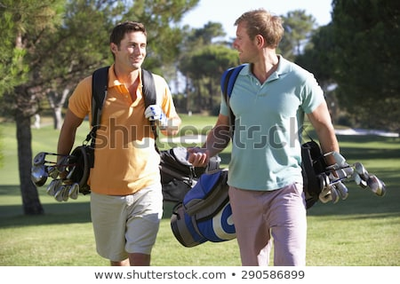 Male Friends Enjoying A Game Of Golf stock photo © monkey_business