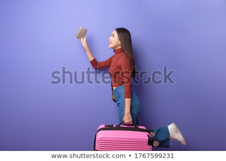 Portrait of an excited young woman with backpack Stock photo © deandrobot