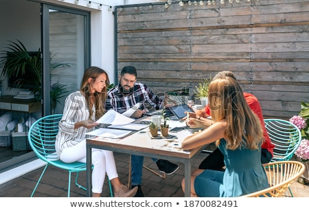 Four business people working outside. Stock photo © IS2