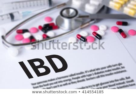 IBD. Medical Concept on Green Background. Stock photo © tashatuvango