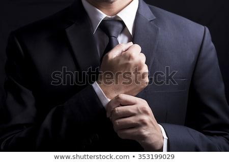 üzletember · megjavít · mandzsettagombok · elegáns · fiatal · divat - stock fotó © feedough