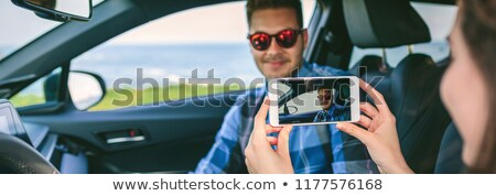 Man taking picture of girlfriend Stock photo © IS2