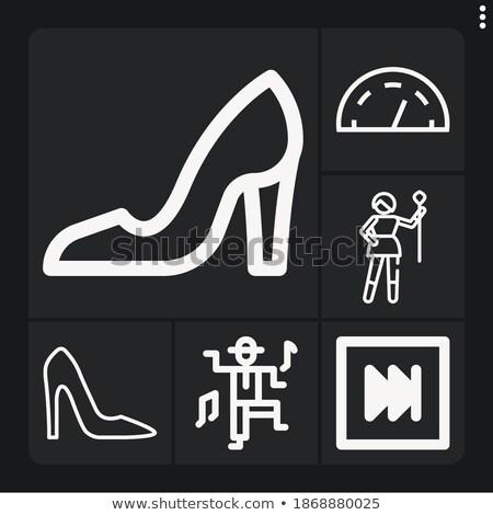 Dancer putting on high heels Stock photo © IS2