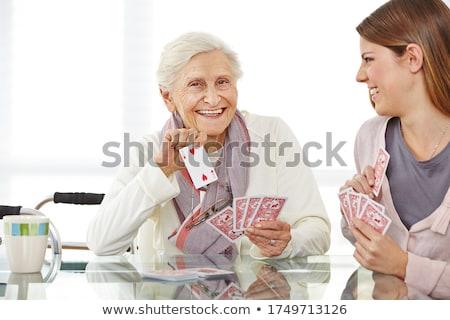 Para karty do gry kobieta zabawy salon sofa Zdjęcia stock © IS2