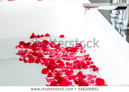 Petals floating in bathtub Stock photo © IS2