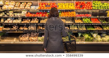 Woman standing in front of organic food store smiling Stock photo © monkey_business