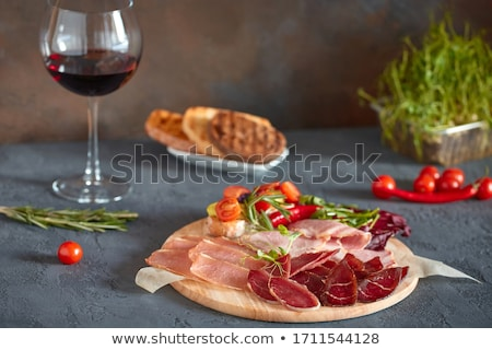 plate of cured ham on table close up stock photo © is2