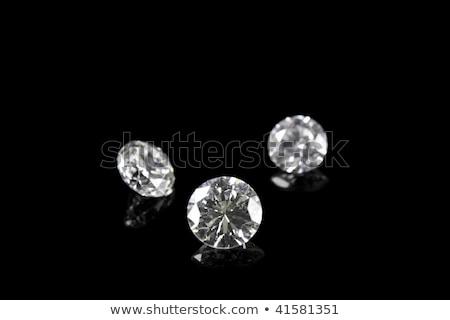 Group of  diamonds on black background Stock photo © AptTone