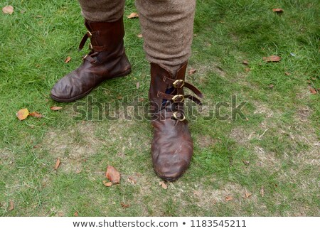 Authentic Medieval leather shoes with buckles Stock photo © sarahdoow