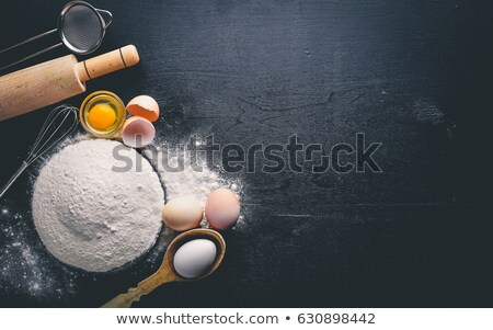 Vintage kitchen wooden utensils on stone table background. Top view. Space for text Stock photo © DenisMArt
