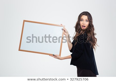 attractive shocked woman with blank banner stock photo © traimak