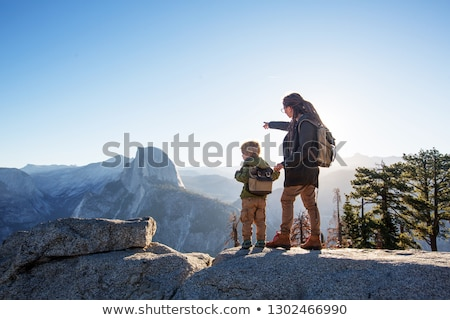 Super mother hiking with toddler in backpack Stock photo © blasbike