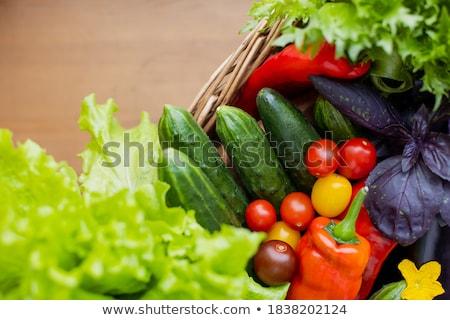 Fresh juicy lettuce in wicker basket Stock photo © brulove