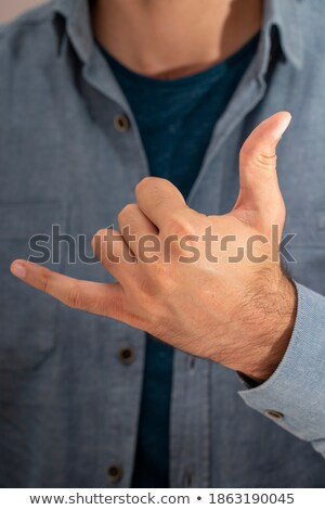 close up of man with alcohol calling on phone Stock photo © dolgachov