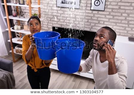 nő · gyűjt · víz · plafon · vödör · boldogtalan - stock fotó © andreypopov
