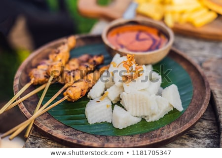 Сток-фото: Indonesian Chicken Satay Or Sate Ayam Served With Lontong Soy Sauce And Peanut Sauce Lifestyle Food