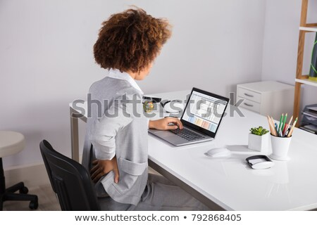 Businesswoman Suffering From Backache While Working In Office Stock photo © AndreyPopov