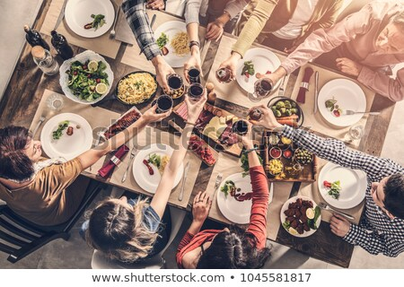 Image from above of cheerful man and woman having dinner at home Stock photo © deandrobot