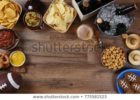 кружка пива плоская маисовая лепешка чипов деревянный стол вечеринка Сток-фото © Alex9500