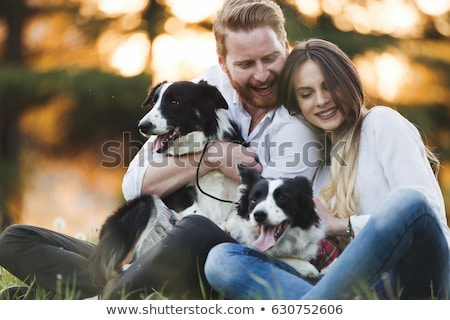 Family with their dog in nature Stock photo © Kzenon