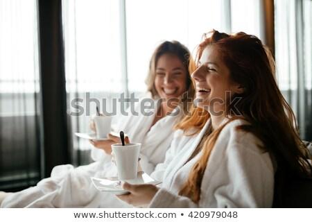 Kadın bornoz rahatlatıcı spa iki güzel bir kadın Stok fotoğraf © Kzenon