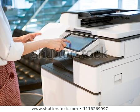 Fiatalember alkalmazott dolgozik gép iroda papír Stock fotó © Elnur