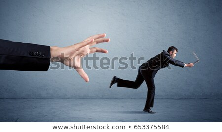 businessman running at work with briefcase in hand stock photo © robuart