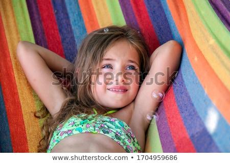 Kislány pihen függőágy portré tengerpart élvezet Stock fotó © Anna_Om