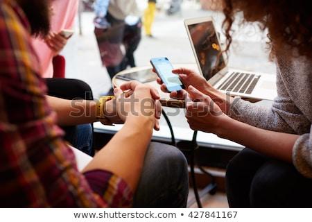 Blogger Using Phone, Social Media Communication Stock photo © robuart