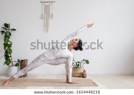 Side view of yoga teacher doing yoga and meditating on a yoga mat in school Stock photo © wavebreak_media