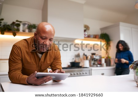 Front view of senior woman with digital tablet looking at camera with her friends behind on sunny da Stock photo © wavebreak_media
