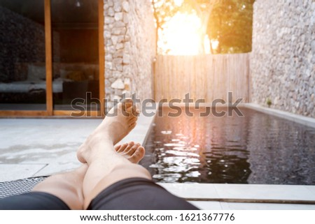 Woman relaxing on deckchair beside swimming pool enjoying vacation time Stock photo © dash