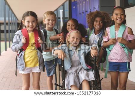 Front view of smiling Caucasian schoolgirl standing in library at elementary school Stock photo © wavebreak_media