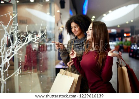 Young woman with purchases in new year shop. Christmas sale, black friday Stock photo © galitskaya