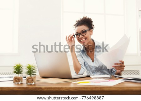 Concentrated successful businesswoman looks attentively in paper, studies terms of contract, holds p Stock photo © vkstudio
