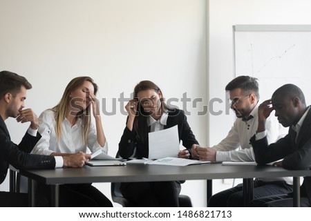 Woman businessman in the room for coworking thinking about the upcoming meeting Stock photo © ElenaBatkova