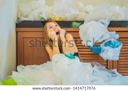 Woman used too many plastic bags that they filled up the entire kitchen. Zero waste concept. The con Stock photo © galitskaya