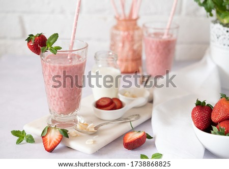 Cold organic fruit juice in glass jars against white background. Healthy drink concept. Homemade bev Stock photo © vkstudio