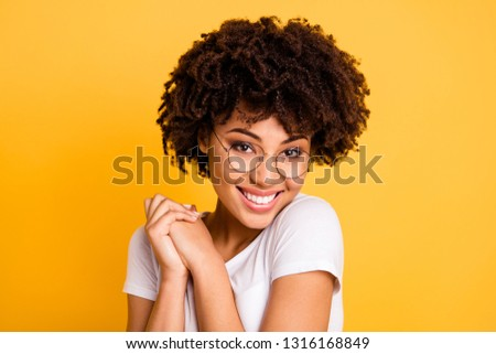 Close up portrait of delighted beautiful Afro woman with bushy curly hair, looks through transparent Stock photo © vkstudio
