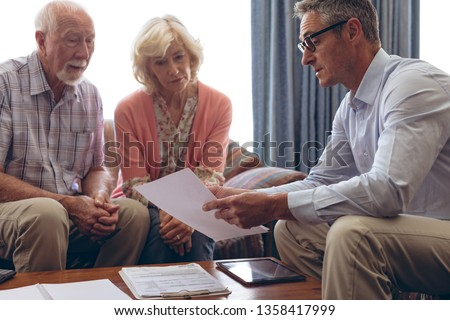 Front view of matured Caucasian male physician interacting with senior Caucasian couple at retiremen Stock photo © wavebreak_media