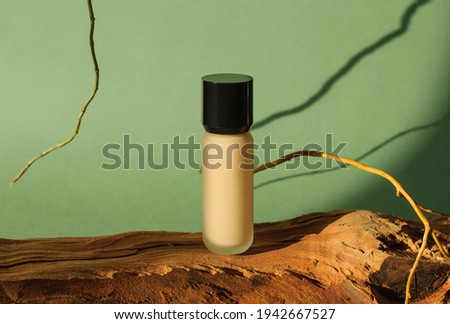 Beige tonal cream bottle make-up fluid foundation base and red l Stock photo © Anneleven