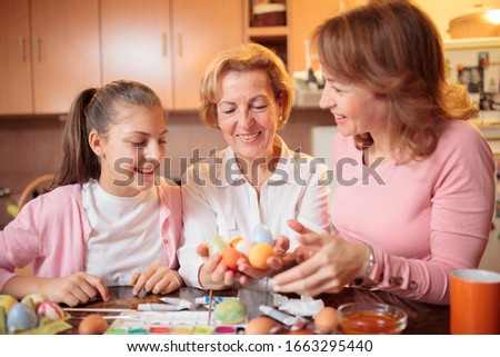 A senior grandmother with is daughter having great time in room Stock photo © Lopolo