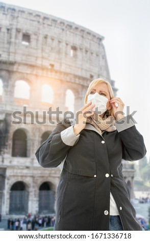 Young Woman Wearing Face Mask Walks Near the The Roman Coliseum  Stock photo © feverpitch