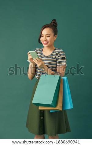 Woman hold shopping bag against the background of Chinese red lanterns for the Chinese New Year. Big Stock photo © galitskaya